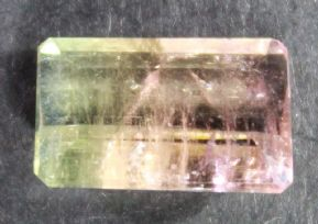Bi-colour pink and olive green Tourmaline, facted, Brazil.  3.41 carats.